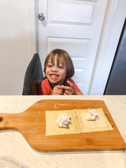 little boy helping make crab rangoon