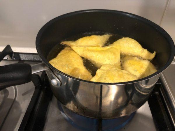 Crab rangoon cooking in pot